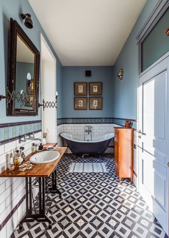 a gorgeous eclectic bathroom done in the shades of blue and copper, with lots of vintage items and furniture
