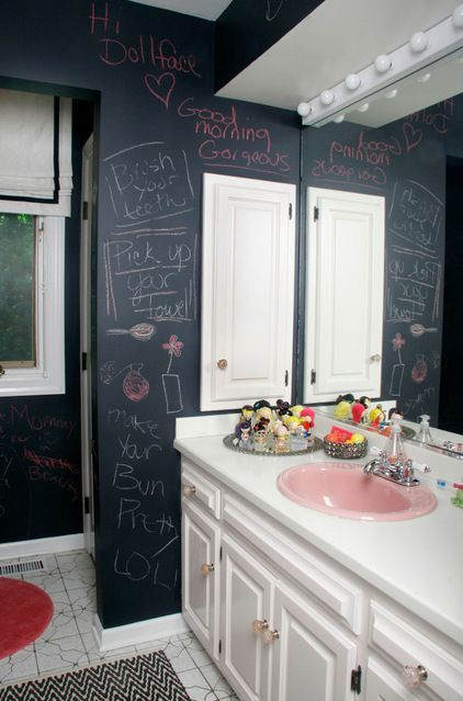 an eclectic bathroom with a vintage vanity and chalkboard walls to inspire kids' art and playing