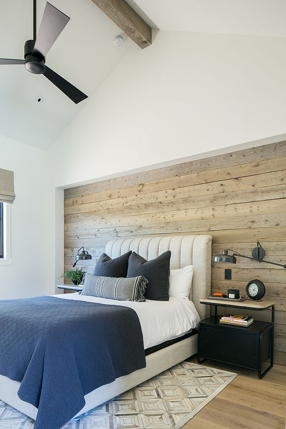 a modern farmhouse bedroom with a statement neutral-colored shiplap wall that adds coziness and helps to pull off the style