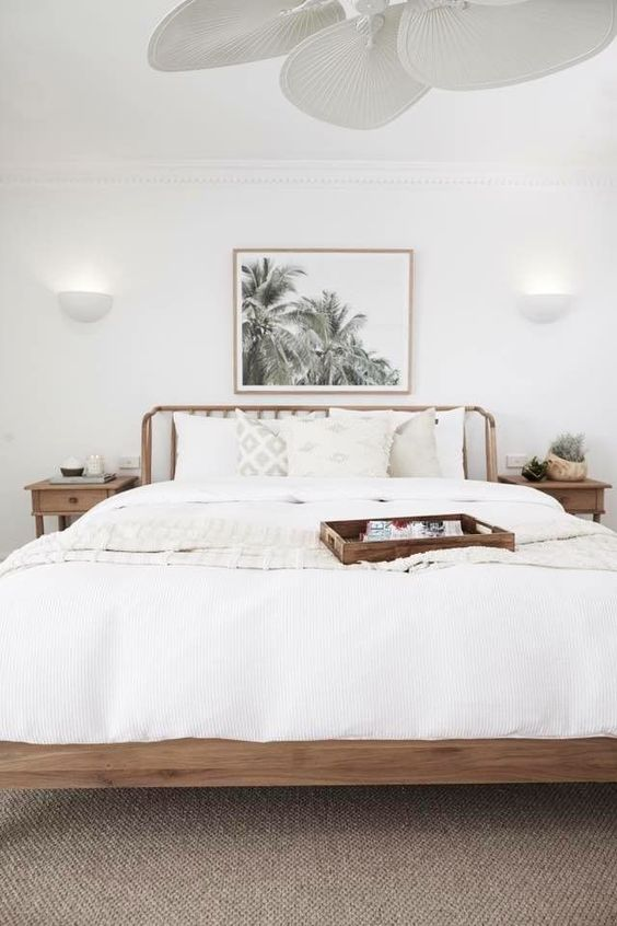 a neutral coastal bedroom, with everything white and a tan floor is a very welcoming space