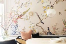 02 a refined dining space with a beautiful statement wall with flora and fauna that cozies up the space