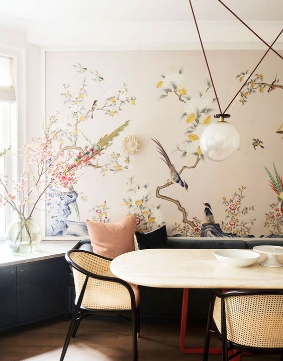 a refined dining space with a beautiful statement wall with flora and fauna that cozies up the space