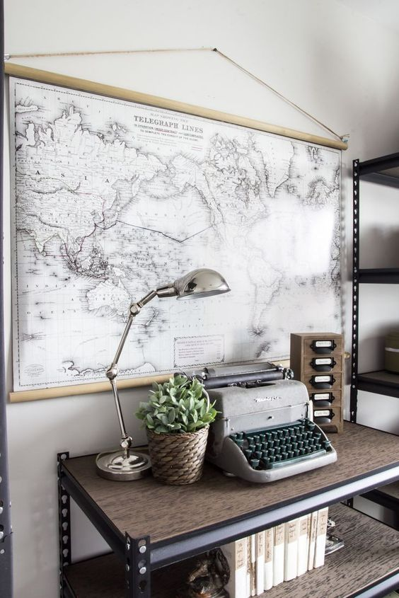 an industrial home office with a black and white world map as an artwork, it adds a refined and chic space