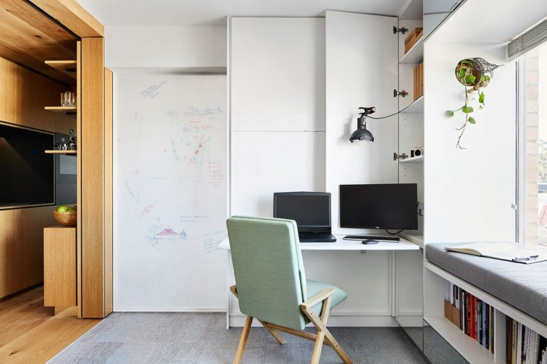 The work station in the living room can be hidden anytime for more functionality of the space