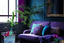 03 a bright purple sofa, pink curtains and a blue printed rug for brightening up a moody space