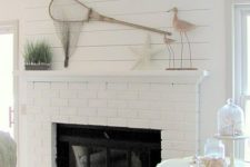 03 a coastal living room with a white brick clad fireplace – whte brick accents the fireplace and adds texture