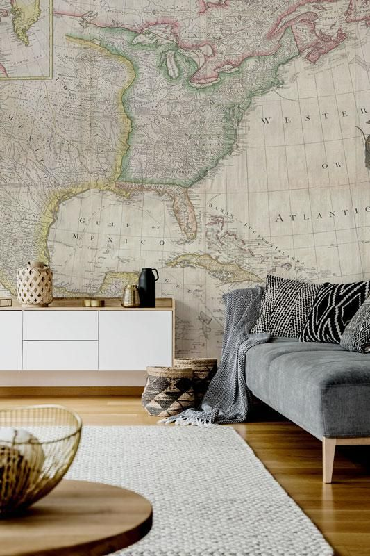 an oversized vintage map wall mural for a boho living room, it will always inspire you to travel