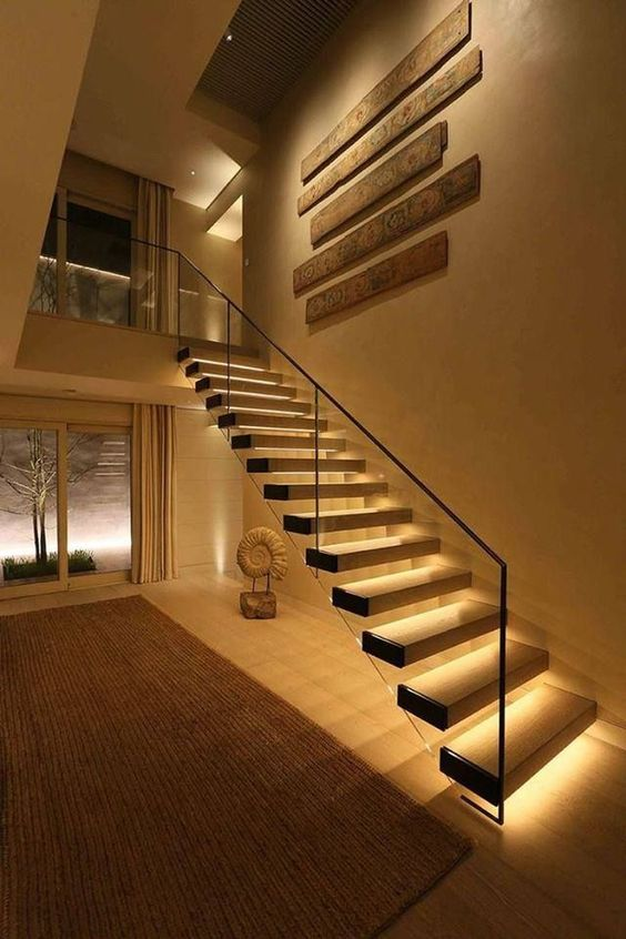 highlight your gorgeous floating staircase with strip lighting lining up each step