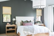 04 a chic farmhouse bedroom done with a black shiplap statement wall that adds drama and elegance to the space