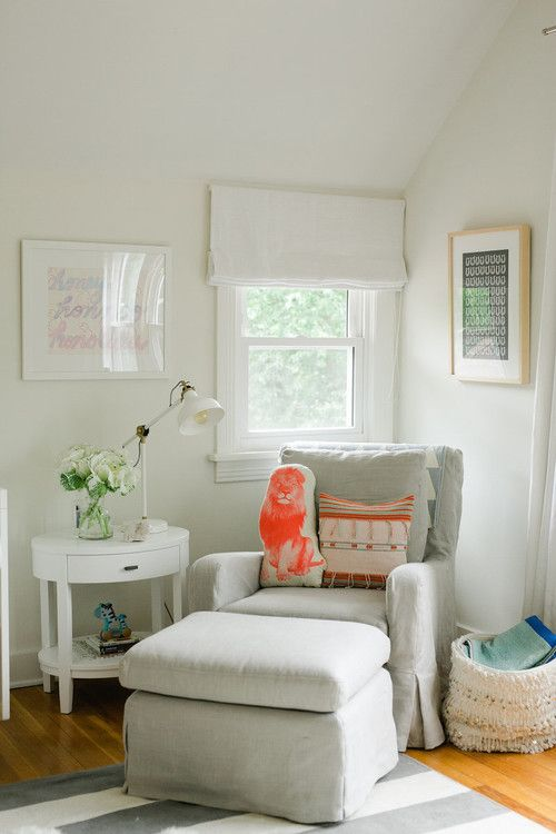 a cozy reading nook with a traditional feel and a small window with Roman shades in neutrals