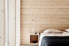 04 a minimal Scandinavian bedroom with wooden walls, a floor and ceiling that make the space welcoming