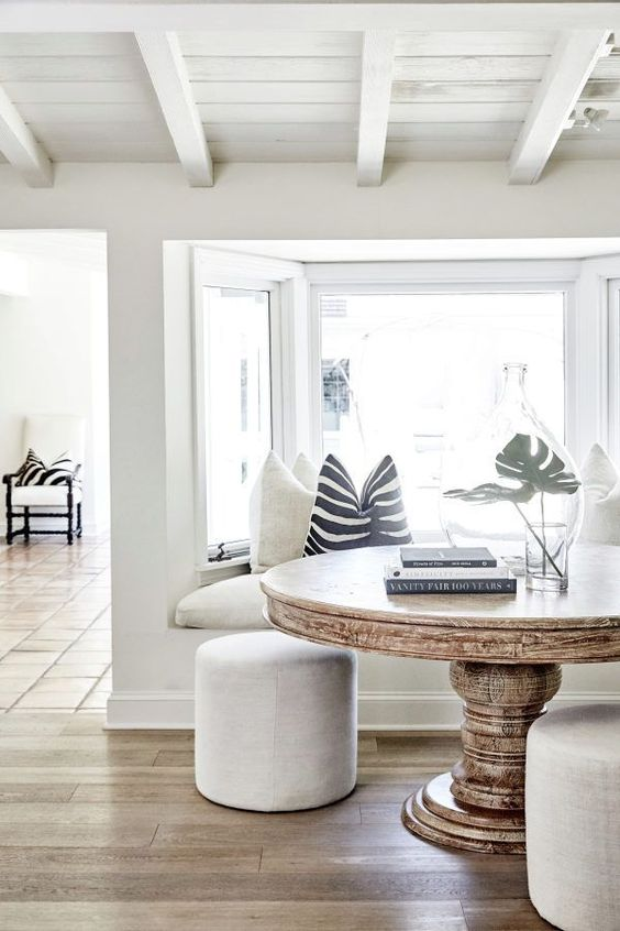 a neutral coastal space in creamy and off-whites, with black and white accessories