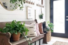 04 a vintage-inspired wooden bench with wooden boxes for storage under it – you can place some if you need