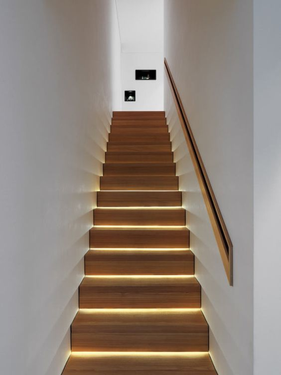 highlight each step integrating strip lighting to make your staircase look contemporary and very bold