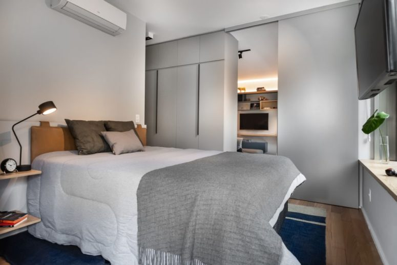 The second bedroom features a comfy leather upholstered bed, much storage and floating nightstands