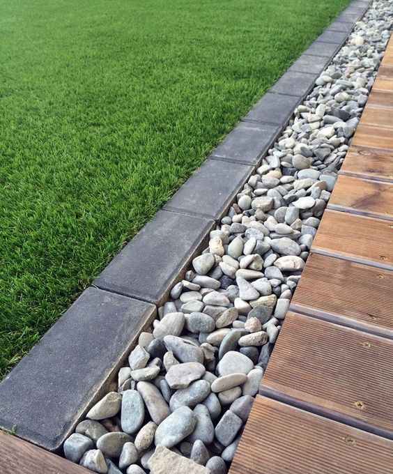a pebble and dark brick border will fit a modern garden and will make it look edgy and stylish