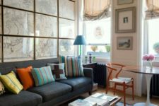 05 an eclectic living room  with a whole statement wall done with framed vintage maps all over