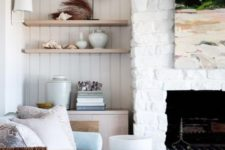 05 another white brick clad fireplace is the coziest and coolest decor feature in the coastal living room