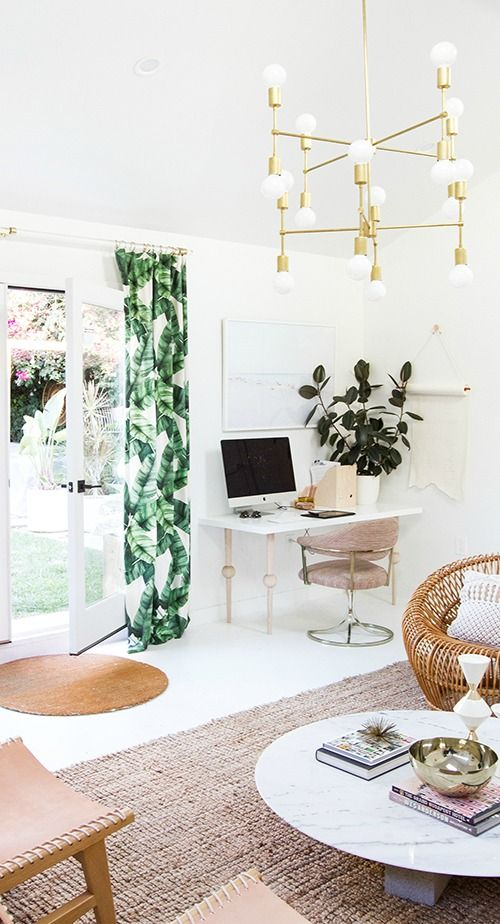 bright tropical leaf print curtains and brass accents bring a bright touch and timeless elegance