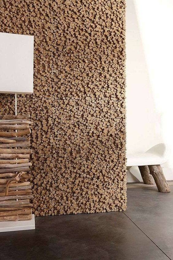 a pixelated wooden wall like this one is a cool idea to add texture and coziness to the space and it looks very catchy