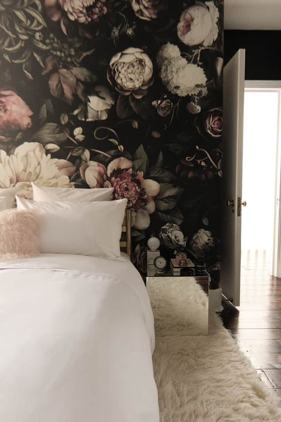 a trendy moody bedroom with ivory as the main color, blush as the secondary one and dark tones for more drama