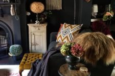06 a white floor and tan and brown colored decor and accessories give this moody space a brighter feel