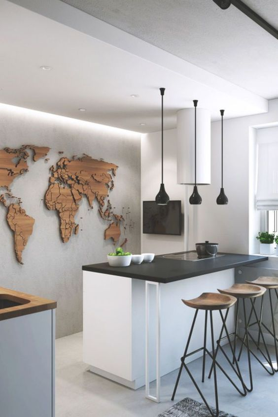 a wooden world map on the wall with pins is a cool idea to look at it while eating at the counter