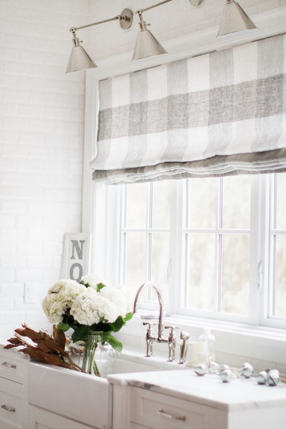 neutral buffalo check check Roman shades are an elegant option for any farmhouse kitchen