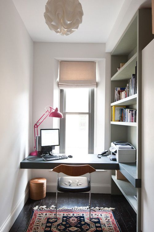 a small home office nook with built-in open shelves that provide storage and fit the space perfectly