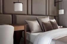 07 a taupe wall with upholstered panels over the bed substitutes the headboard and makes the space cozier