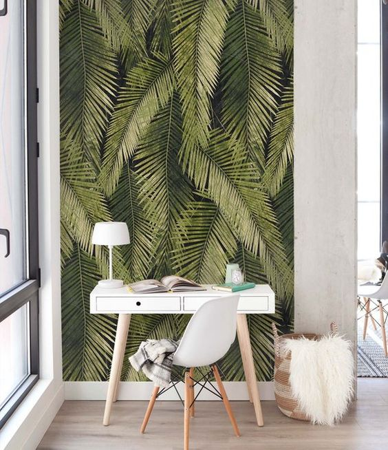 a tiny home workspace accented with removable banana leaf wallpaper for a blam and fun touch