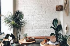 07 a white brick wall adds texture to this cozy boho chic nook and makes a nce backdrop for greenery and stained furniture