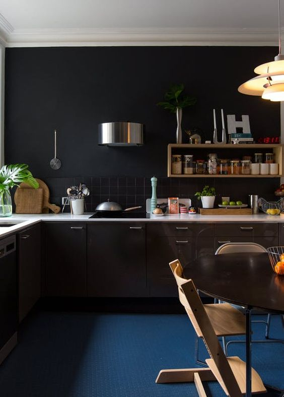 a white countertop and a navy floor add color to the kitchen making it look fresher