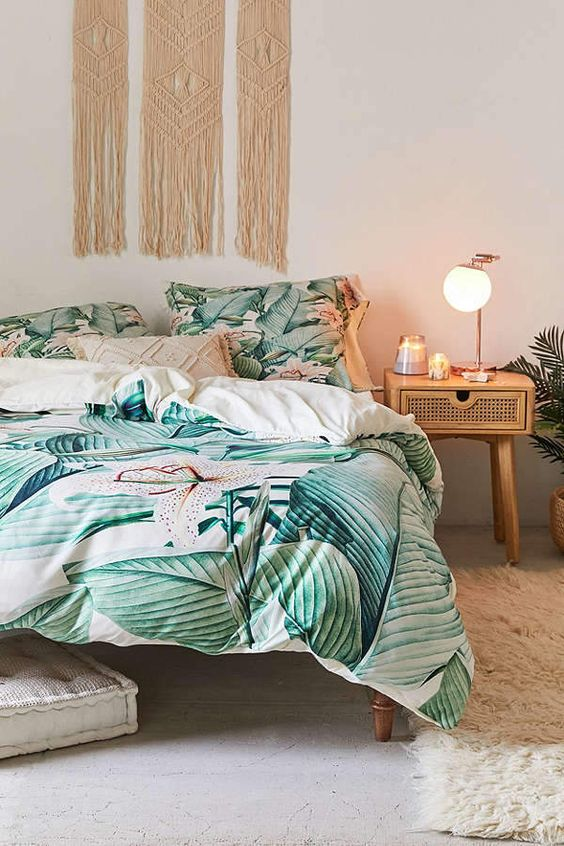 bring a touch of tropical decor to your bedroom easily with tropical print bedding