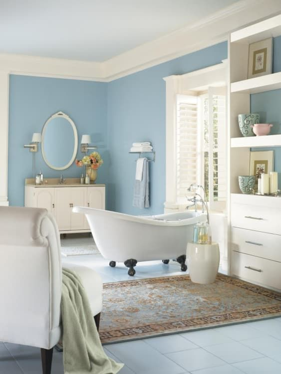 ivory as the main shade, blue as the secondary and some tan touches to make up a welcoming bathroom
