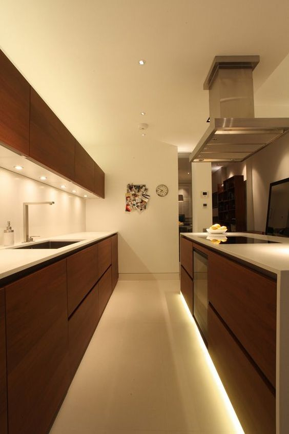strip lighting under the lower cabinets is a cool idea to give an edge to your kitchen