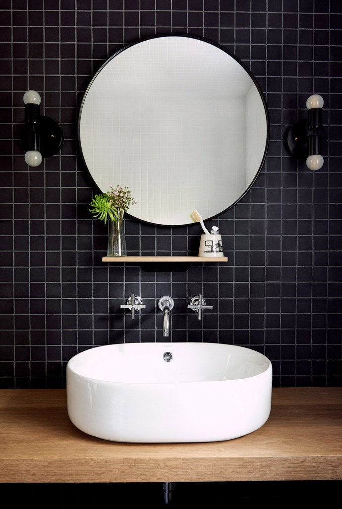 chic bathroom design with a black wall