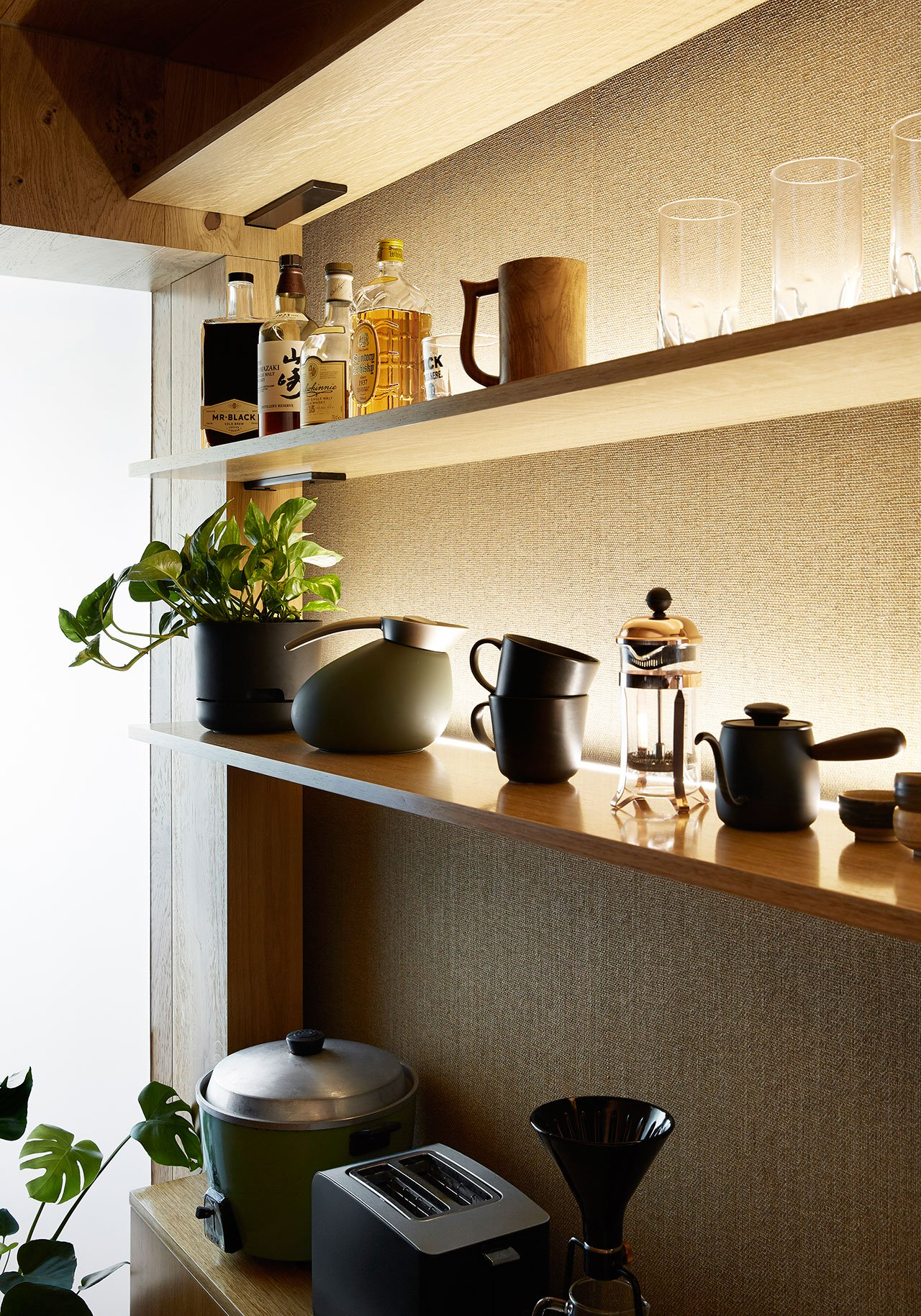 The kitchen shows off a comfortable open shelving unit with all the necesary things