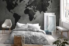 08 a minimalist bedroom with a dark world map mural as a decor statement in the space