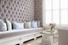 08 a refined living room with an upholstered taupe wall with a built-in bench brings luxury and coziness