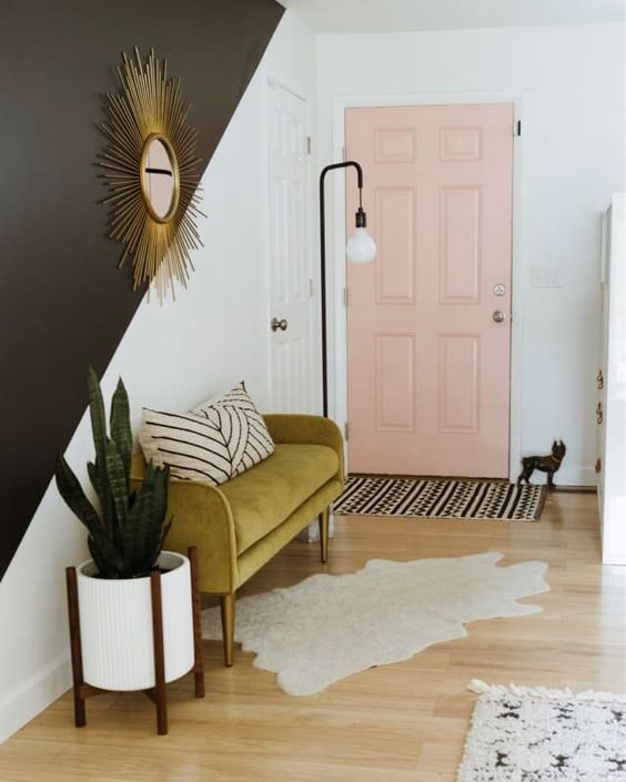 make a mid-century modern statement with a mustard-colored upholstered mini sofa in your entryway