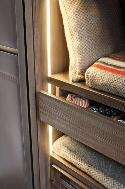 strip lights accenting each shelf and drawer will let you easily find each piece even if the other lights are off