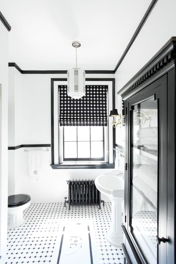 a bold monochromatic bathroom with printed Roman shades that add interest to the space
