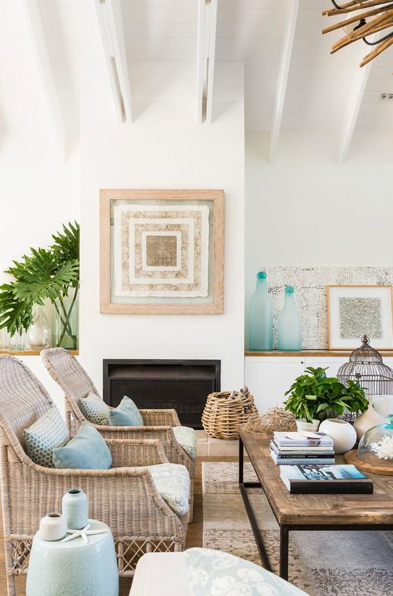 a cozy coastal living room with tan and beige touches, creamy shades and very light blue accessories
