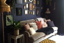 09 a moody living room done with a white floor and colorful cushions and a gallery wall with vintage artworks