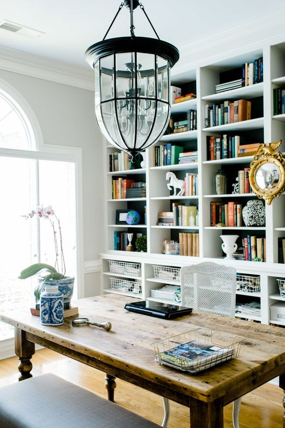 a whole wall taken by shelves and wire baskets below for smaller stuff is a cool and contemporary idea