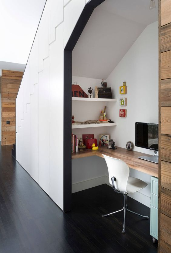 an under the stairs space can also become a nice space for storage or a real home office