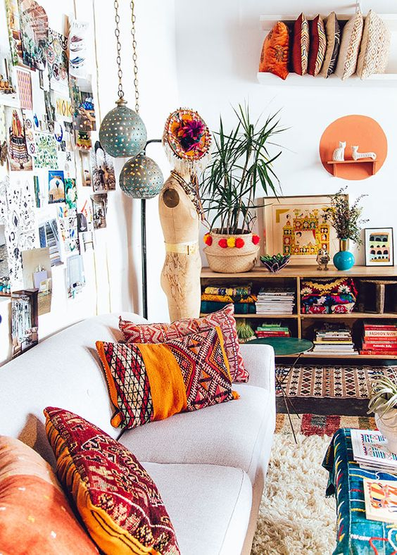 colorful printed pillows make the space look more boho like and bold