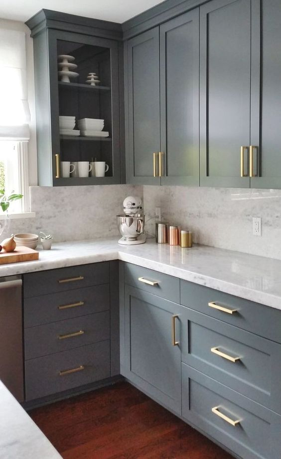 spruce up with neutral grey kitchen with gold handles to make it bolder and more chic