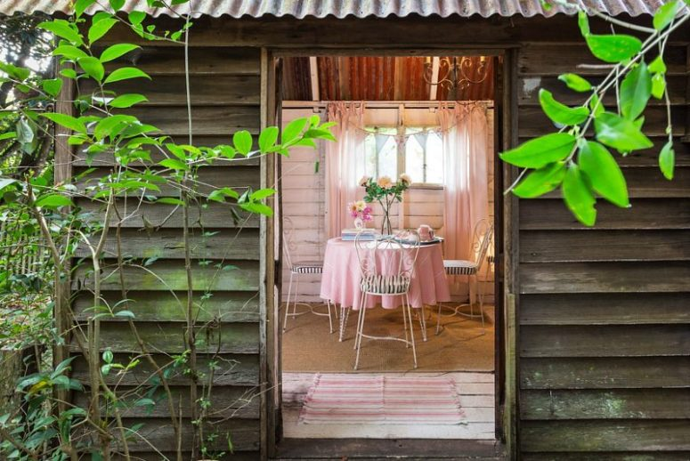 There's also a little sweet garden shed with a cozy eating zone with forged furniture, which can be moved outside